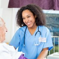 Young female nurse with elderly man - Medical Communication Skills Coaching | Oxford, UK | OMCS
