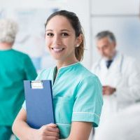 Young female nurse with clipboard - Medical Communication Skills Coaching | Oxford, UK | OMCS